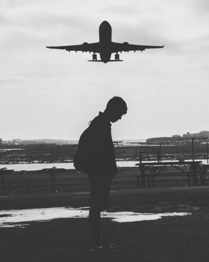 plane-flies-over-a-man-in-a-long-distance-relationship