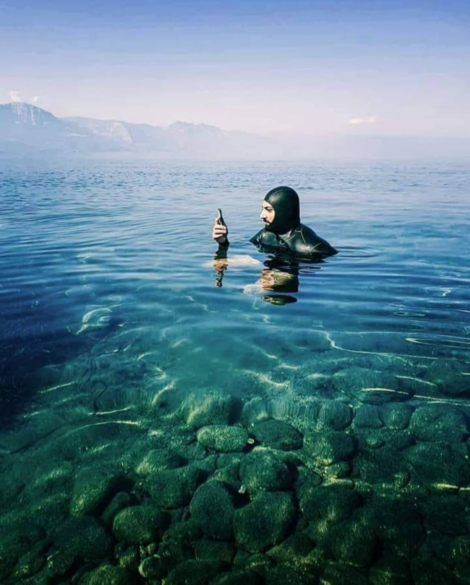 person in suit in the sea