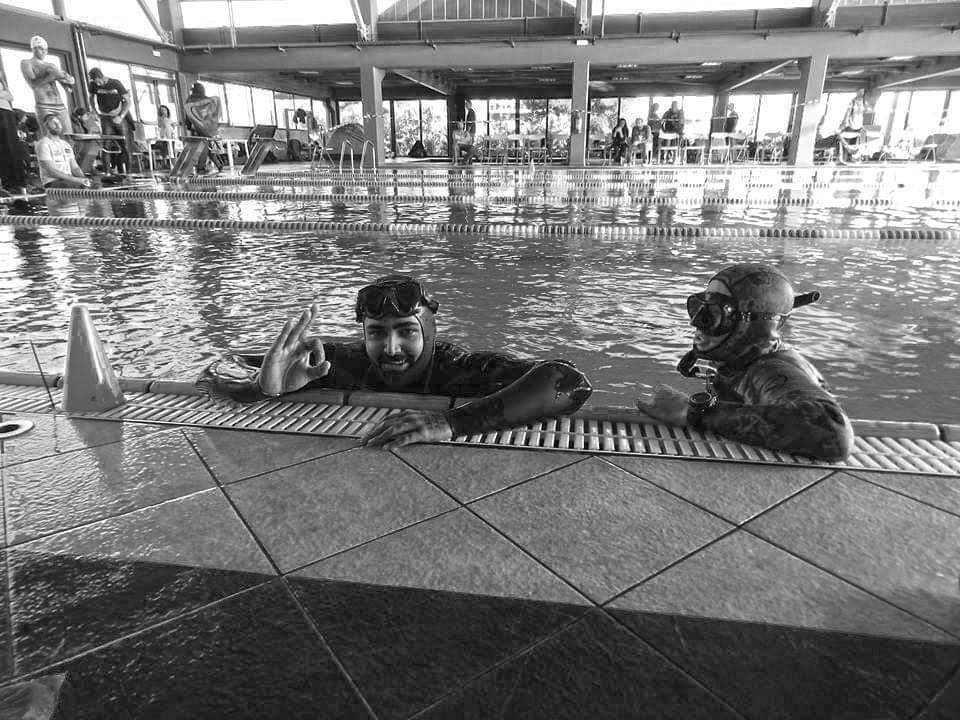 people in black and white in a pool